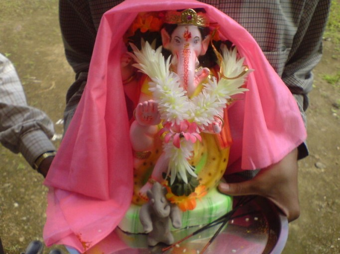 Last year, my elder bro held Ganesha while bringing him home